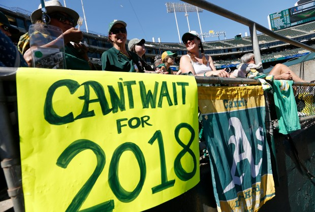 Oakland Athletics fans Lee Uehisa, of Concord, Carrie Olejnik, of Pleasanton, and Dina Ultsch, of Point Richmond, from left, watch in the fourth inning of their MLB game against the Seattle Mariners at the Coliseum in Oakland, Calif., on Wednesday, Sept. 27, 2017. The A's beat the Mariners 6-5 in their last home game of the season. (Jane Tyska/Bay Area News Group)