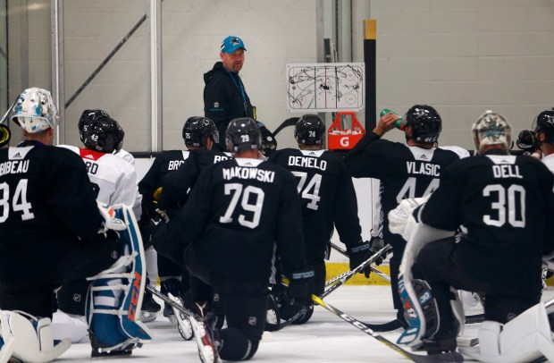 Sharks coach Peter DeBoer talks with his team as the San Jose Sharks practice Friday, Sept., Sept. 15, 2017, at Solar4America Ice in San Jose, California. (Patrick Tehan/Bay Area News Group)