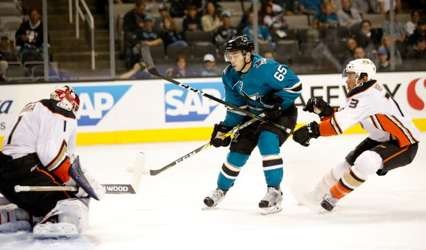 Anaheim Ducks goaltender Reto Berra (1) makes a save against the San Jose Sharks' Danny O'Regan (65) with the help of Anaheim Ducks' Andy Welinski (73) in the first period of their pre-season NHL game at SAP Center in San Jose, Calif., on Tuesday, September 19, 2017. (Josie Lepe/Bay Area News Group)