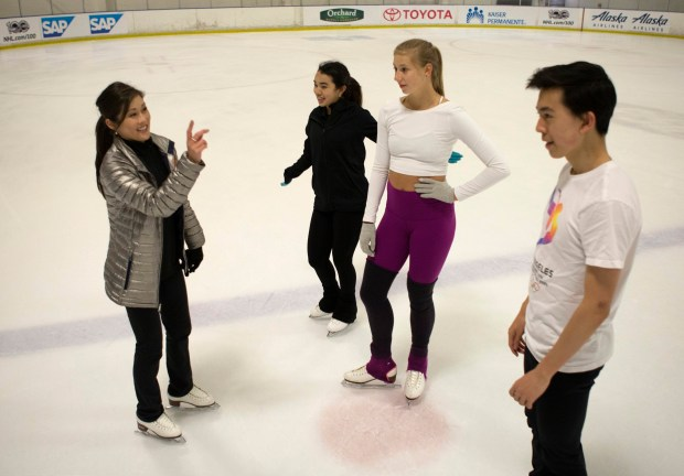 From left, Olympic champion Kristi Yamaguchi talks with reigning U.S. Women's Figure Skating champion Karen Chen of Fremont, Olympian, Polina Edmunds of San Jose and the current U.S. Men's Figure Skating silver medalist Vincent Zhou of Palo Alto as they practice at Solar4America Ice in San Jose, California, Friday, Sept. 1, 2017 for an upcoming exhibition. (Patrick Tehan/Bay Area News Group)