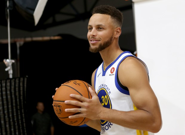 Golden State Warriors' Stephen Curry poses for a photograph during the team's media day at their practice facility in Oakland, Calif., on Friday, Sept. 22, 2107. (Anda Chu/Bay Area News Group)