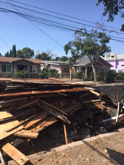 Debris piles up near Concepcion Romero's flooded home on South 20th Street in San Jose (Photo courtesy of Amanda Hawes)