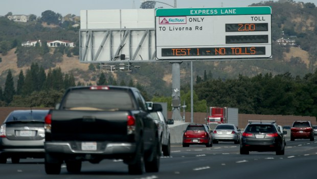 An express lane sign along Northbound Interstate 680 is tested just before Sycamore Valley Road off-ramp in Danville, Calif., on Friday, Sept. 29, 2017. The lane will be open Monday, Oct. 9 to solo drivers willing to pay the toll. (Anda Chu/Bay Area News Group)