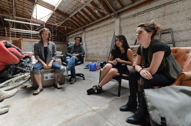 Tanya Rutherford, far right, Misha Naiman, Daniel Fennelly, and Jae Starfox, far left, talk about their plans at a warehouse in Oakland, Calif., on Saturday, Sept. 16, 2017. A group of artists think they have found a place that they can build out, with the proper permits, into a new collective live/work warehouse living space. Many of the hopeful future residents come from other warehouse collectives that were closed down following the Ghost Ship fire that killed 36 people. (Dan Honda/Bay Area News Group)
