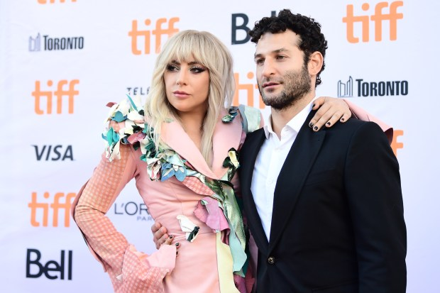 "Chris Moukarbel, director of ""Gaga: Five Foot Two,"" with the performer during the Toronto International Film Festival. (Emma McIntyre/Getty Images)"