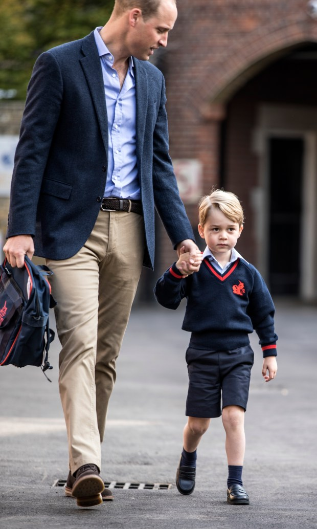 Britain's Prince George accompanied by Britain's Prince William (L), Duke of Cambridge arrives for his first day of school at Thomas's school in Battersea, southwest London on September 7, 2017. / AFP PHOTO / POOL / RICHARD POHLE (Photo credit should read RICHARD POHLE/AFP/Getty Images)