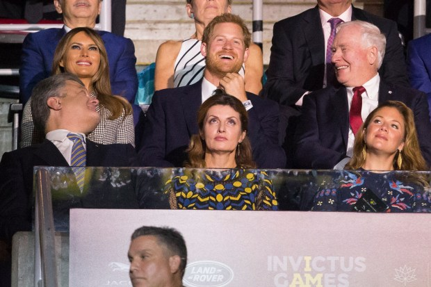 Grintain's Prince Harry (C) shares a laugh with Ukrainian President Petro Poroshenko (L), US first lady Melania Trump and Governor General David Johnston (R) during the opening ceremonies of the Invictus Games in Toronto, Ontario, September 23, 2017. / AFP PHOTO / Geoff Robins (Photo credit should read GEOFF ROBINS/AFP/Getty Images)