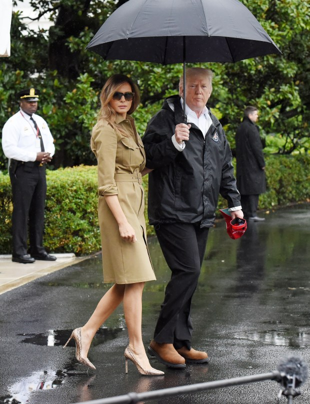 WASHINGTON, DC - SEPTEMBER 2: (AFP OUT) U.S. President Donald Trump walks with first lady Melania Trump prior to their Marine One departure from the White House September 2, 2017 in Washington, DC. The President and first lady are traveling to Texas to visit individuals impacted by Hurricane Harvey. Photo by Olivier Douliery-Pool/Getty Images)