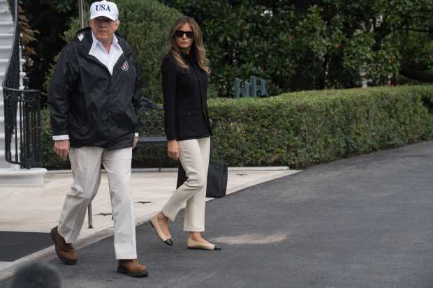 US President Donald Trump and First Lady Melania Trump depart the White House in Washington, DC, on September 14, 2017, for Florida. The Trumps will visit areas affected by Hurricane Irma. / AFP PHOTO / NICHOLAS KAMM (Photo credit should read NICHOLAS KAMM/AFP/Getty Images)