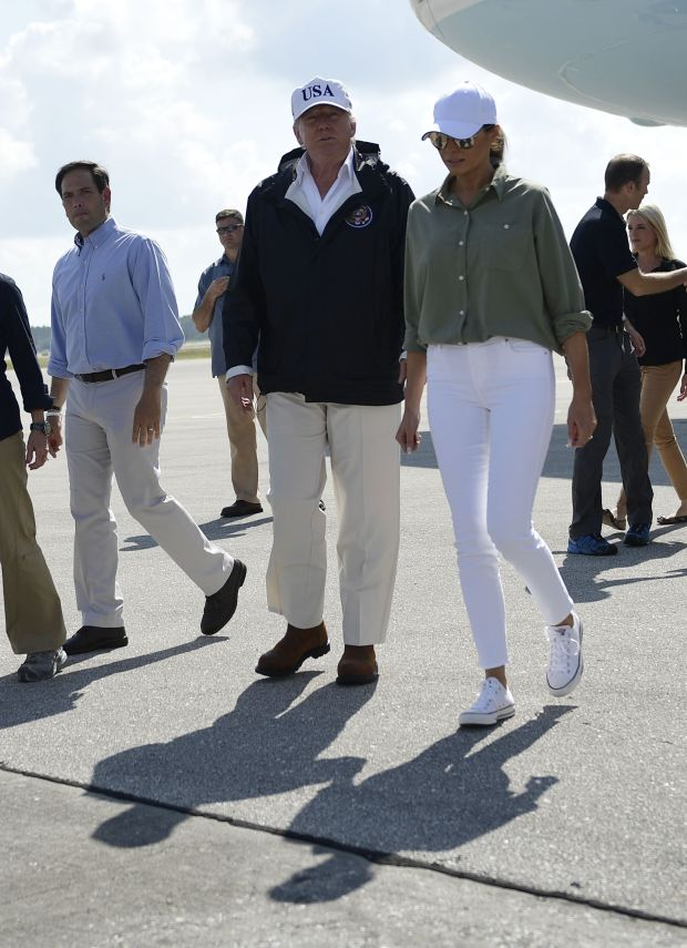 US President Donald Trump and First Lady Melania Trump, with US Senator Marco Rubio (L), arrive in Fort Myers, Florida, on September 14, 2017.Trump visits areas affected by Hurricane Irma. / AFP PHOTO / Brendan Smialowski (Photo credit should read BRENDAN SMIALOWSKI/AFP/Getty Images)