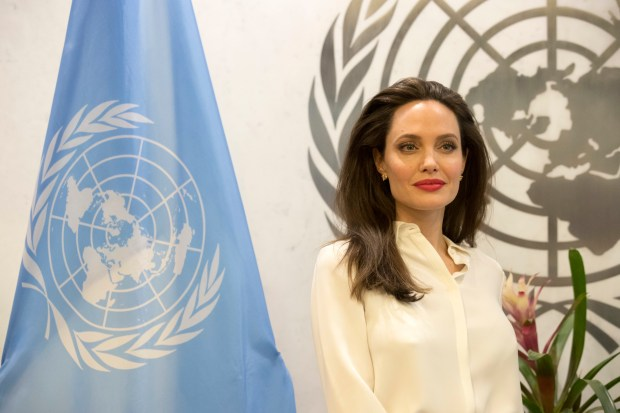 Actress Angelina Jolie poses for photographers before meeting with United Nations Secretary-General Antonio Guterres, Thursday, Sept. 14, 2017 at United Nations headquarters. (AP Photo/Mary Altaffer)