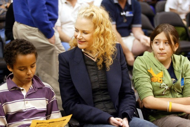 LOS ANGELES - DECEMBER 25: Actress Nicole Kidman and her children Connor (L) and Isabella (R) attend a game between the Los Angeles Lakers and the Miami Heat at the Staples Center December 25, 2004 in Los Angeles, California. NOTE TO USER: User expressly acknowledges and agrees that, by downloading and/or using this Photograph, User is consenting to the terms and conditions of the Getty Images License Agreement. (Photo by Matthew Simmons/Getty Images)