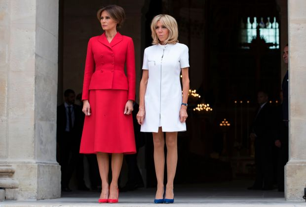 US First Lady Melania Trump (L) and French president's wife Brigitte Macron (R), stand outside the Army Museum during a welcome ceremony at Les Invalides in Paris, on July 13, 2017, as part of US president's 24-hour trip that coincides with France's national day and the 100th anniversary of US involvement in World War I.Donald Trump arrived in Paris for a 24-hour trip that coincides with France's national day and the 100th anniversary of US involvement in World War I. / AFP PHOTO / POOL / IAN LANGSDON (Photo credit should read IAN LANGSDON/AFP/Getty Images)
