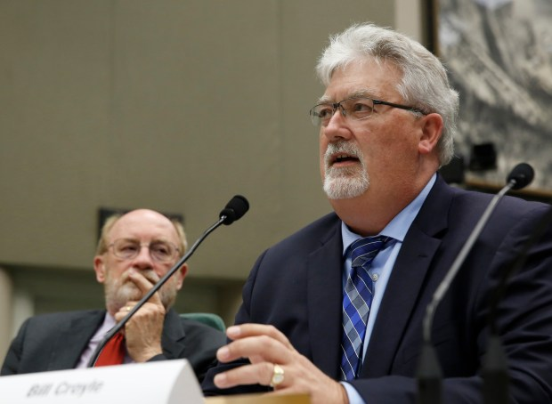 Bill Croyle, the acting director of the Department of Water Resources, flanked by Resources Secretary John Laird, left, discusses the damaged spillways of the Oroville Dam during a Assembly committee hearing Thursday, May 11, 2017, in Sacramento, Calif. Lawmakers cited numerous factors emerging from technical reports done by two independent teams of experts on the Oroville Dam's two spillway's, that contributed to the near collapse of the spillways that caused the evacuation of nearly 200,000 people downstream of the Oroville Dam in February. (AP Photo/Rich Pedroncelli)