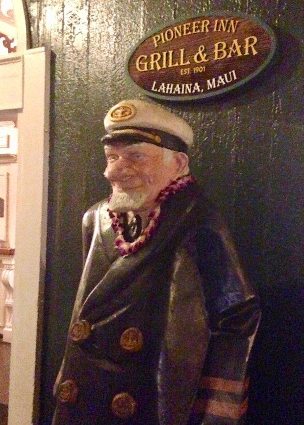 One of the perks of staying at Lahaina's historic Pioneer Inn is the selfiephoto-op with the life-size, big-nosed wooden sea captain who stands guard out front. (Jackie Burrell/Bay Area News Group)