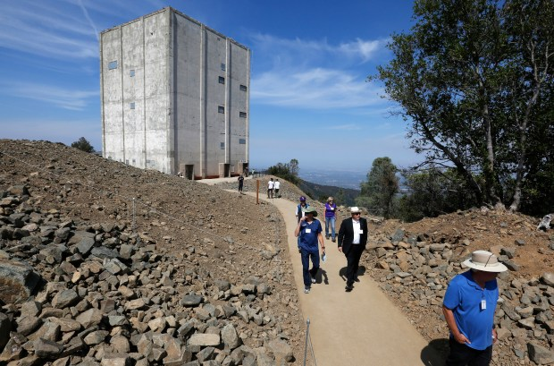 As the iconic radar tower provides a backdrop, visitors take in the view after the opening ceremony for the new public space atop Mount Umunhum near San Jose, California, Saturday, Sept. 16, 2017. The Midpeninsula Regional Open Space District, a public agency that owns the 3,486-foot peak in the Santa Cruz Mountains east of Los Gatos, spent $25 million over eight years on the project. (Patrick Tehan/Bay Area News Group)