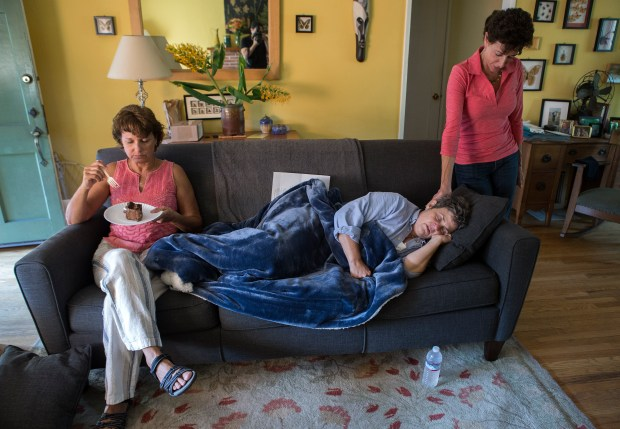 Christine Fazio, right and Renee Farrell left, keep Jil Finnegan company as she rests after her farewell party at her home in Oakland, California on Saturday, September 16, 2017. Finnegan, who has cancer, has opted to die under California's right-to-die law on her wedding anniversary. The party also served to celebrate the birthday of her husband Geoff Protz. (LiPo Ching/Bay Area News Group)