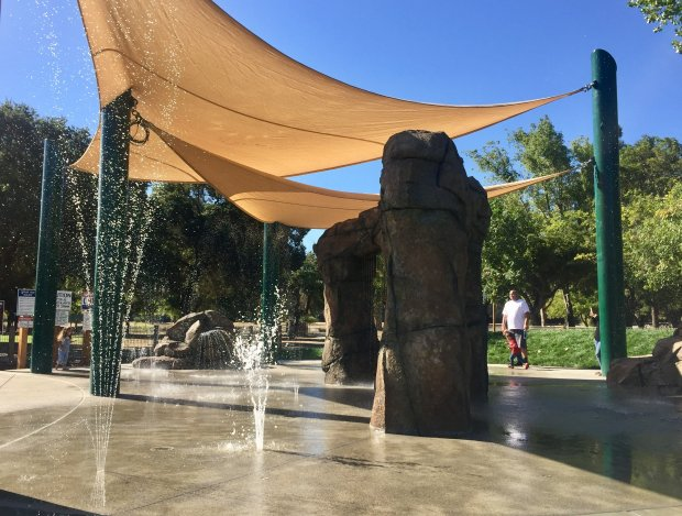 A new playground at Hellyer County Park in San Jose includes a waterfeature with jets, sprinklers and waterfalls. (Sal Pizarro/Bay Area News Group)