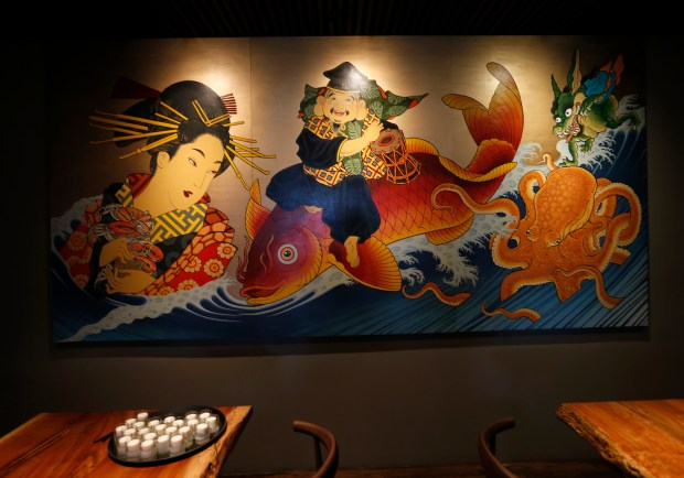 A geisha mural is seen in the back dining room at Shinmai on San Pablo Avenue in Oakland, Calif., on Wednesday, Sept. 6, 2017. The new restaurant features a a focused menu with izakaya, ramen, sashimi and a robata grill. (Jane Tyska/Bay Area News Group)
