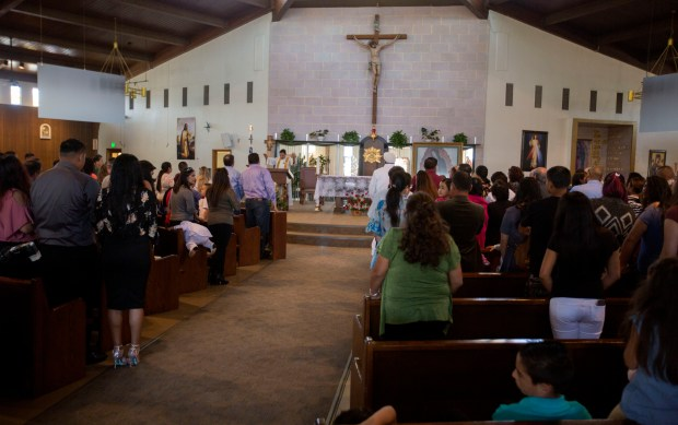 Visitors attend a baptismal ceremony at Our Lady of Guadalupe Church in San Jose, California, on Saturday, Sept. 23, 2017. The church remained open 24 hours a day through Saturday, for parishioners who wish to say a prayer for those in Mexico following the devastating earthquake this week. (Patrick Tehan/Bay Area News Group)