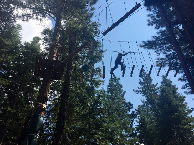 The Tahoe Treetop Adventure Park in Tahoe Vista mixes thrills and lake views as you traverse the ziplines and bridges. (Karen D'Souza)