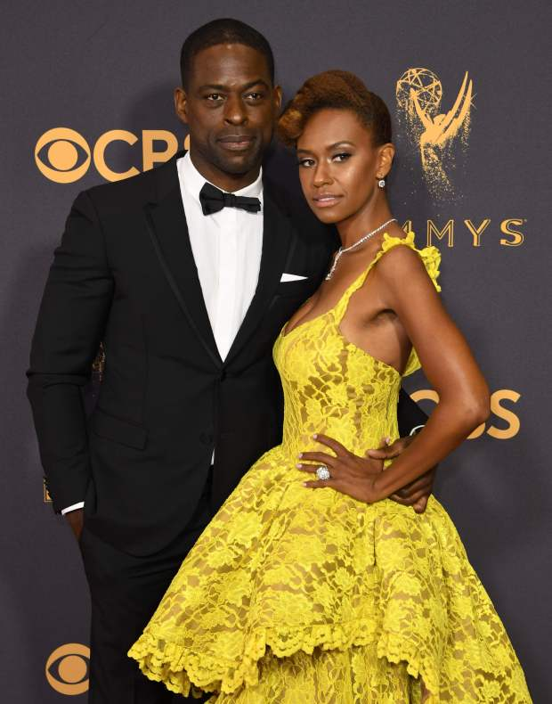 Ryan Michelle Bathe (R) and Sterling K. Brown arrive for the 69th Emmy Awards at the Microsoft Theatre on September 17, 2017 in Los Angeles, California. / AFP PHOTO / Mark RALSTONMARK RALSTON/AFP/Getty Images