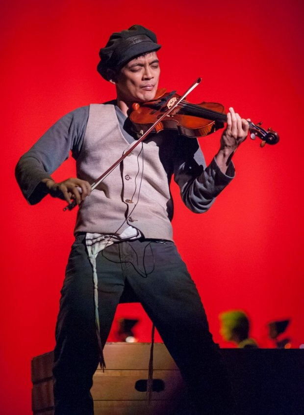 Eric Sun plays the violin during a Sunnyvale Community Players production of 'Fiddler on the Roof.' Sun, 33, says he was diagnosed with glioblastoma and has four months to live. (Photo by David Yanez and courtesy of Sunnyvale Community Players)