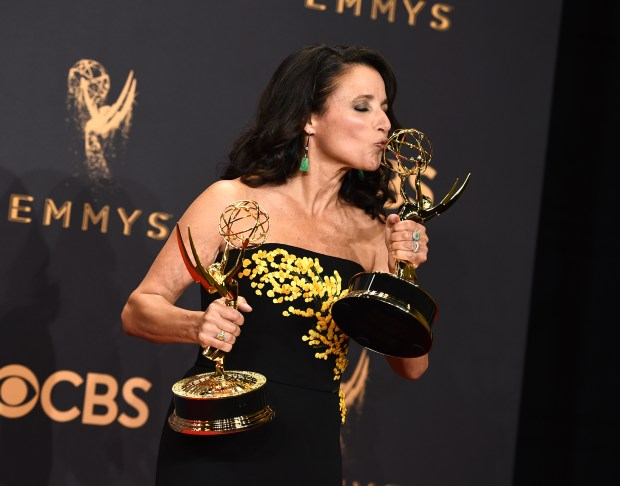 "Julia Louis-Dreyfus poses in the press room with her awards for outstanding lead actress in a comedy series and outstanding comedy series for ""Veep"" at the 69th Primetime Emmy Awards on Sunday, Sept. 17, 2017, at the Microsoft Theater in Los Angeles. (Photo by Jordan Strauss/Invision/AP)"