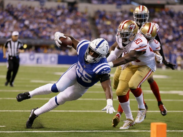 Indianapolis Colts' Marlon Mack (25) is tackled by San Francisco 49ers' Jaquiski Tartt (29) during the second half of an NFL football game, Sunday, Oct. 8, 2017, in Indianapolis. (AP Photo/Michael Conroy)