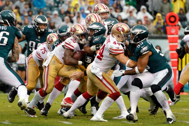San Francisco 49ers' Carlos Hyde (28) is stopped as he runs the ball during the second half of an NFL football game against the Philadelphia Eagles, Sunday, Oct. 29, 2017, in Philadelphia. (AP Photo/Chris Szagola)