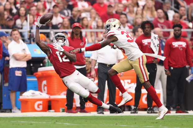 GLENDALE, AZ - OCTOBER 01: Wide receiver John Brown #12 of the Arizona Cardinals can't make a catch under pressure from cornerback Rashard Robinson #33 of the San Francisco 49ers during the first half of the NFL game at the University of Phoenix Stadium on October 1, 2017 in Glendale, Arizona. (Photo by Christian Petersen/Getty Images)