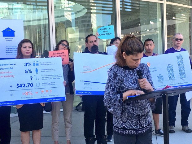 Frances Rivera said her rent has become unaffordable after multiple increases. She called for stronger renter protections by tying increases to inflation.