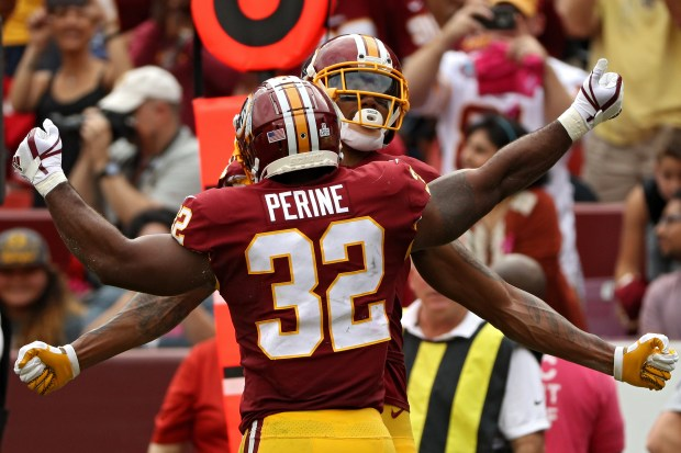 LANDOVER, MD - OCTOBER 15: running back Samaje Perine #32 of the Washington Redskins celebrates a touchdown with teammates against the San Francisco 49ers during the second quarter at FedExField on October 15, 2017 in Landover, Maryland. (Photo by Patrick Smith/Getty Images)