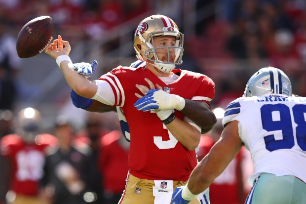 SANTA CLARA, CA - OCTOBER 22: C.J. Beathard #3 of the San Francisco 49ers is stripped of the ball by DeMarcus Lawrence #90 of the Dallas Cowboys during their NFL game at Levi's Stadium on October 22, 2017 in Santa Clara, California. (Photo by Ezra Shaw/Getty Images)