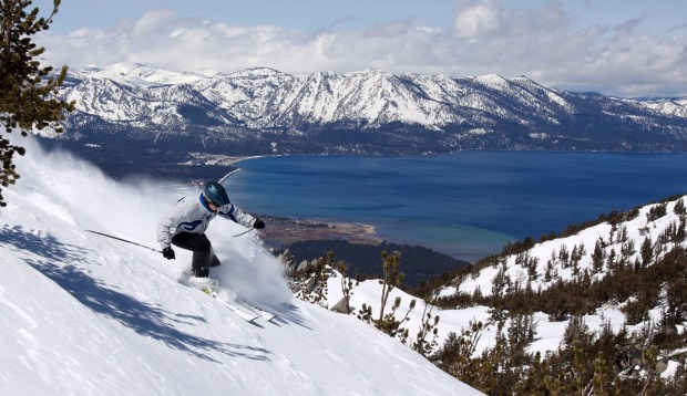 With Lake Tahoe as a backdrop, a skier kicks up some powder at Heavenly Ski Resort, Wednesday, April 14, 2010 in South Lake Tahoe, Calif. New snow and favorable temperatures have enabled mid-winter snow conditions into mid-April on several Sierra ski mountains. Great conditions notwithstanding, some resorts will close this week although Heavenly has extended their season until April 25. (AP Photo/Dino Vournas)