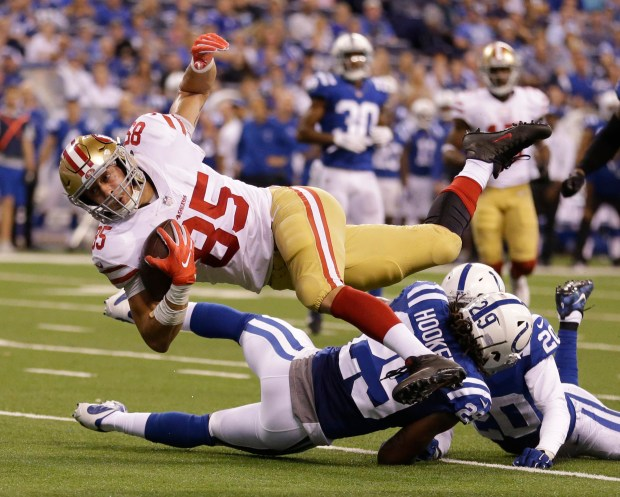 San Francisco 49ers' George Kittle (85) is tackled by Indianapolis Colts' Malik Hooker during the second half of an NFL football game, Sunday, Oct. 8, 2017, in Indianapolis. (AP Photo/Michael Conroy)