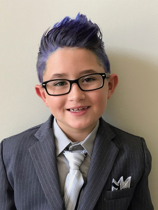 Luca Sinno in his outfit for school pictures. (Dana Sinno via AP)