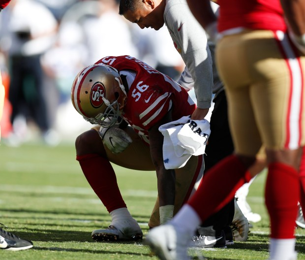 San Francisco 49ers' Reuben Foster (56) kneels after being injured against the Dallas Cowboys in the third quarter of their NFL game at Levi's Stadium in Santa Clara, Calif. on Sunday, Oct. 22, 2017. (Nhat V. Meyer/Bay Area News Group)