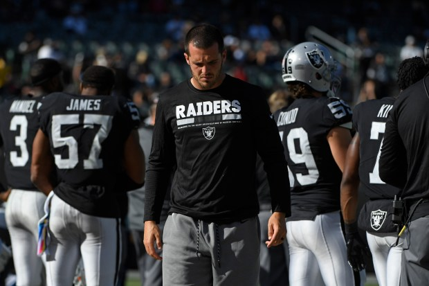 Oakland Raiders quarterback Derek Carr (4) paces the bench while playing the Baltimore Ravens in the fourth quarter of their NFL game at the Coliseum in Oakland, Calif. on Sunday, Oct. 8, 2017. Baltimore defeated Oakland 30-17. (Jose Carlos Fajardo/Bay Area News Group)