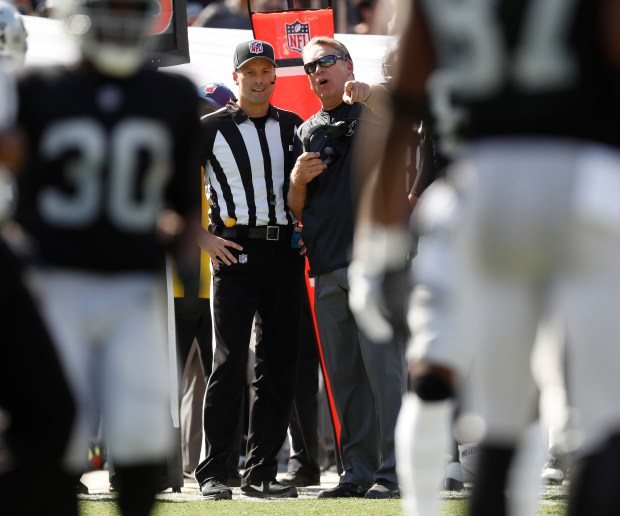 Oakland Raiders head coach Jack Del Rio talks to a referee during their game against the Los Angeles Chargers in the first quarter of their NFL game at the Coliseum in Oakland, Calif. on Sunday, Oct. 15, 2017. (Nhat V. Meyer/Bay Area News Group)