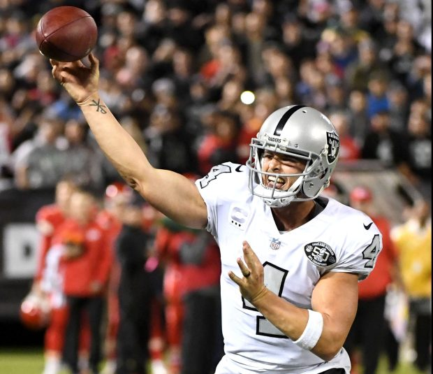 Oakland Raiders quarterback Derek Carr (4) throws a tying touchdown pass to Michael Crabtree in the last seconds of their NFL game against the Kansas City Chiefs at the Coliseum in Oakland, Calif. on Thursday, Oct. 19, 2017. The Raiders went on to win the game 30-31. (Doug Duran/Bay Area News Group)