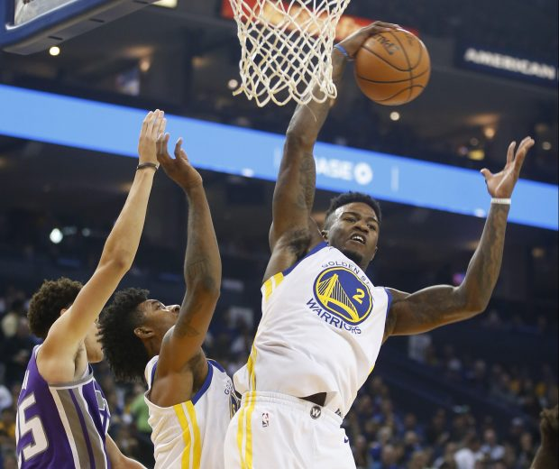 Golden State Warriors forward Jordan Bell (2) grabs a rebound against the Sacramento Kings in the first quarter at Oracle Arena on Friday, Oct. 13, 2017, in Oakland, Calif. (Jim Gensheimer/Bay Area News Group)