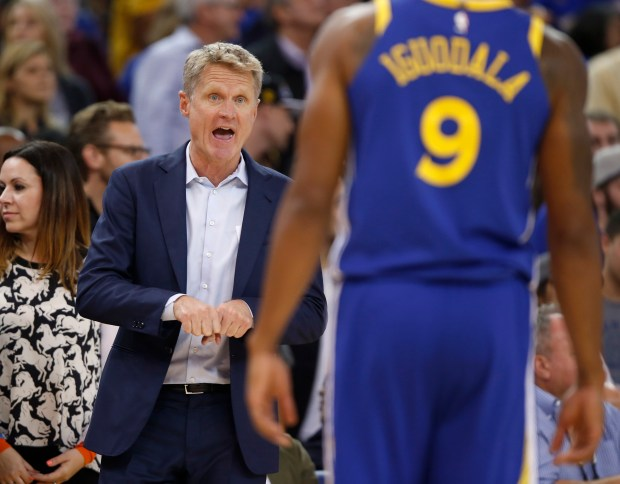 Golden State Warriors head coach Steve Kerr talks to Golden State Warriors' Andre Iguodala (9) during their game against the Detroit Pistons in the fourth quarter at Oracle Arena in Oakland, Calif. on Sunday, Oct. 29, 2017. (Nhat V. Meyer/Bay Area News Group)