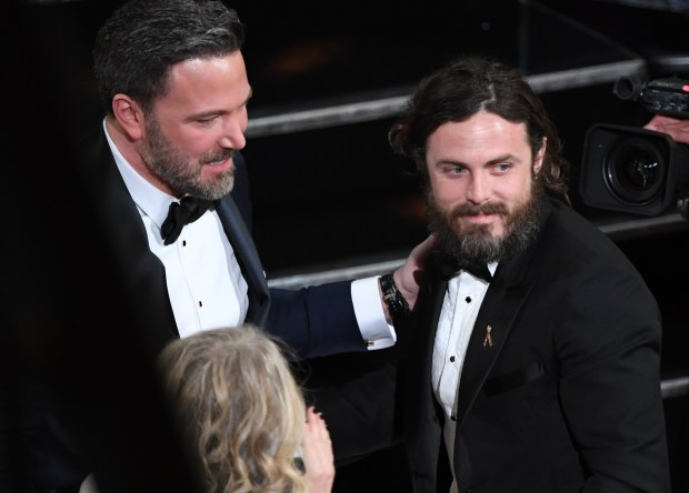 "Winner for Best Actor ""Manchester By The Sea"" Casey Affleck (R) is embraced by his brother Ben Affleck on stage at the 89th Oscars on February 26, 2017 in Hollywood, California. / AFP / Mark RALSTON (Photo credit should read MARK RALSTON/AFP/Getty Images)"