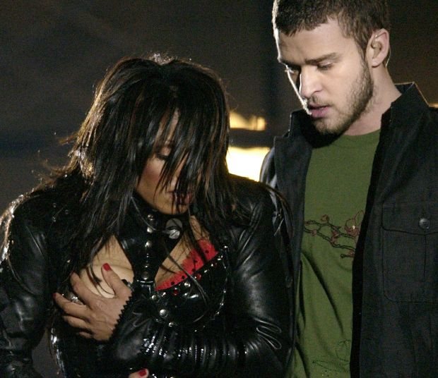 """**FILE** In a Sunday Feb. 1, 2004 file photo, entertainer Janet Jackson, left, covers her breast after her outfit came undone during the half time performance with Justin Timberlake at Super Bowl XXXVIII in Houston. A federal appeals court in Philadelphia threw out out a $550,000 fine issued by the Federal Communications Commission against CBS Corp. Monday, July 21, 2008, for the 2004 Super Bowl halftime show that ended with Janet Jackson's breast-baring """"wardrobe malfunction.""""(AP Photo/David Phillip, File)"""