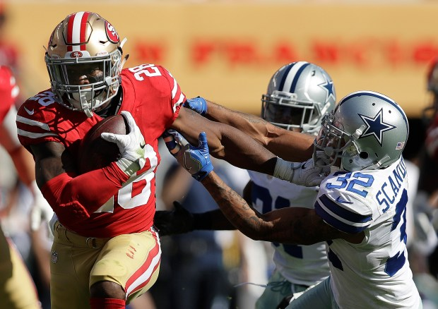 San Francisco 49ers running back Carlos Hyde (28) runs against Dallas Cowboys defensive back Orlando Scandrick (32) during the first half of an NFL football game in Santa Clara, Calif., Sunday, Oct. 22, 2017. (AP Photo/Marcio Jose Sanchez)