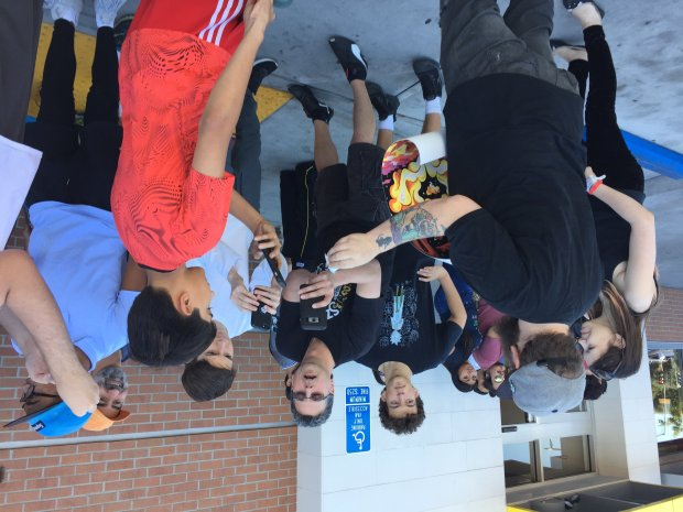 Fans waiting in line snap photos of one of the limited editionSchezuan dipping sauces displayed by a lucky customer on Saturday, Oct. 7, 2017 at a Concord McDonald's restaurant. (Matthias Gafni/East Bay Times)