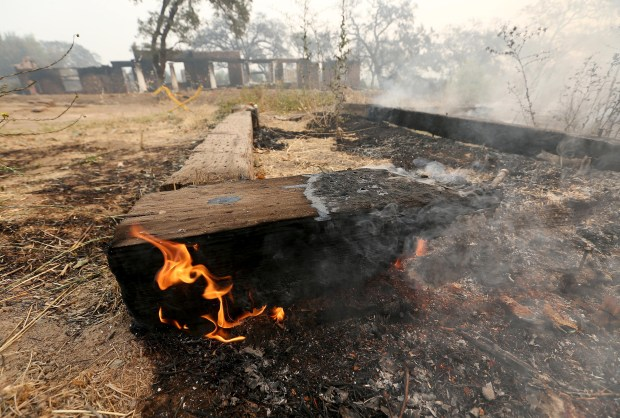 Flames burn at the destroyed Signorello Estate along the Silverado Trail in Napa, Calif., on Tuesday, Oct. 10, 2017. The Napa Fire destroyed many homes and businesses, including several wineries. (Jane Tyska/Bay Area News Group)