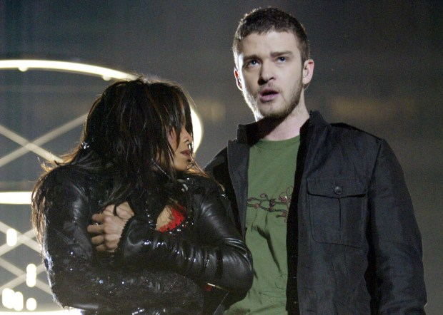 HOUSTON, TX - FEBRUARY 1: Singers Janet Jackson and surprise guest Justin Timberlake perform during the halftime show at Super Bowl XXXVIII between the New England Patriots and the Carolina Panthers at Reliant Stadium on February 1, 2004 in Houston, Texas. At the end of the performance, Timberlake tore away a piece of Jackson's outfit. (Photo by Frank Micelotta/Getty Images)