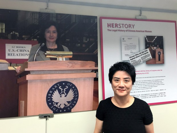 Chang Chiu the curator of the exhibit 'HERstory,' at the Saratoga Library on Sept. 30.  (Brandy Miceli/Staff Photographer)